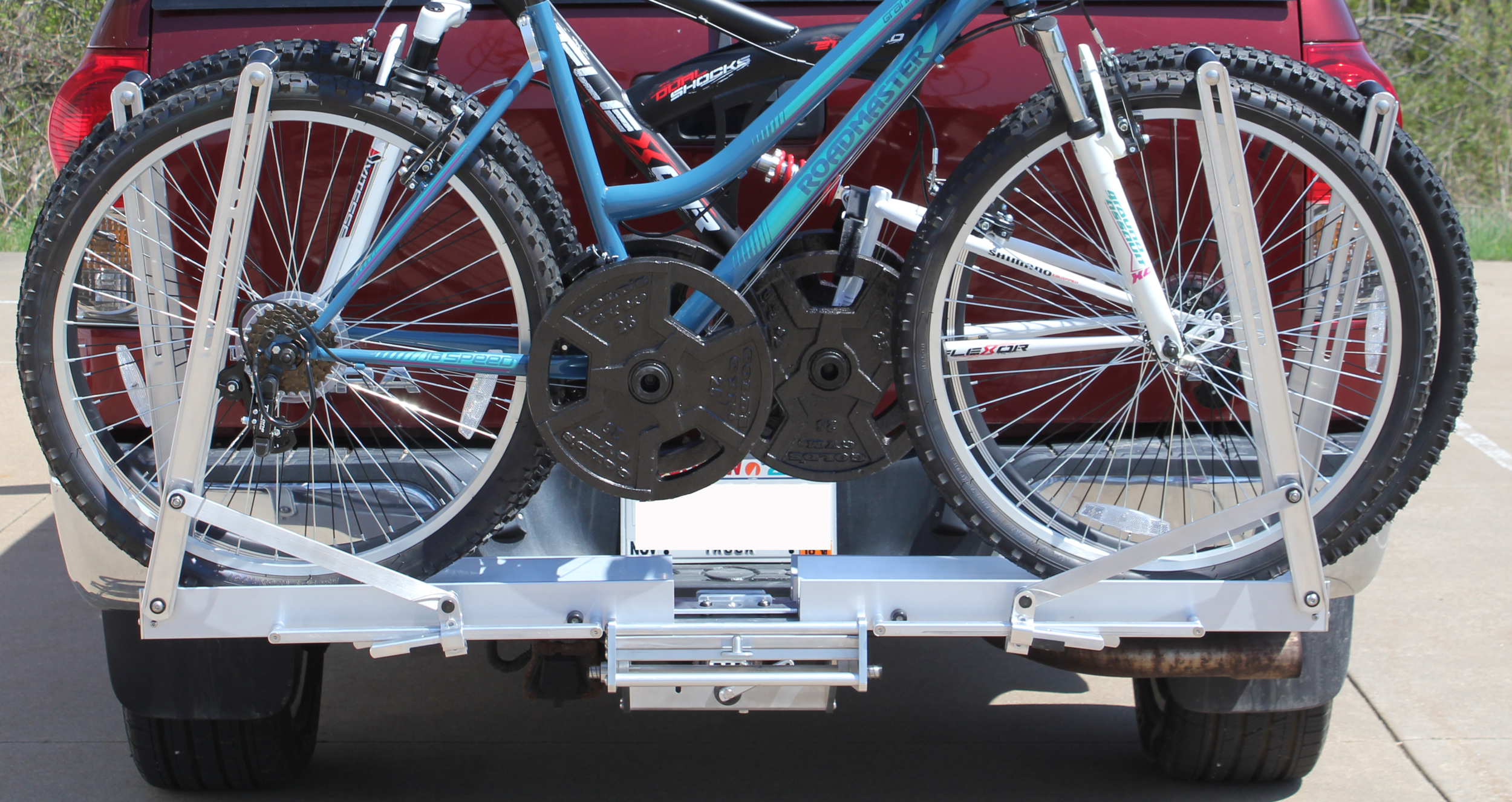 Quik Rack Mach 2 -  Shown with 50 lbs. of weights added per bike for testing. Each bike weights over 80 lbs. The new tray and mounting design allows for much heavier bikes like electric bikes up to 100 lbs. Our original Quik-Rack had a bike weight limit of 50 lbs.