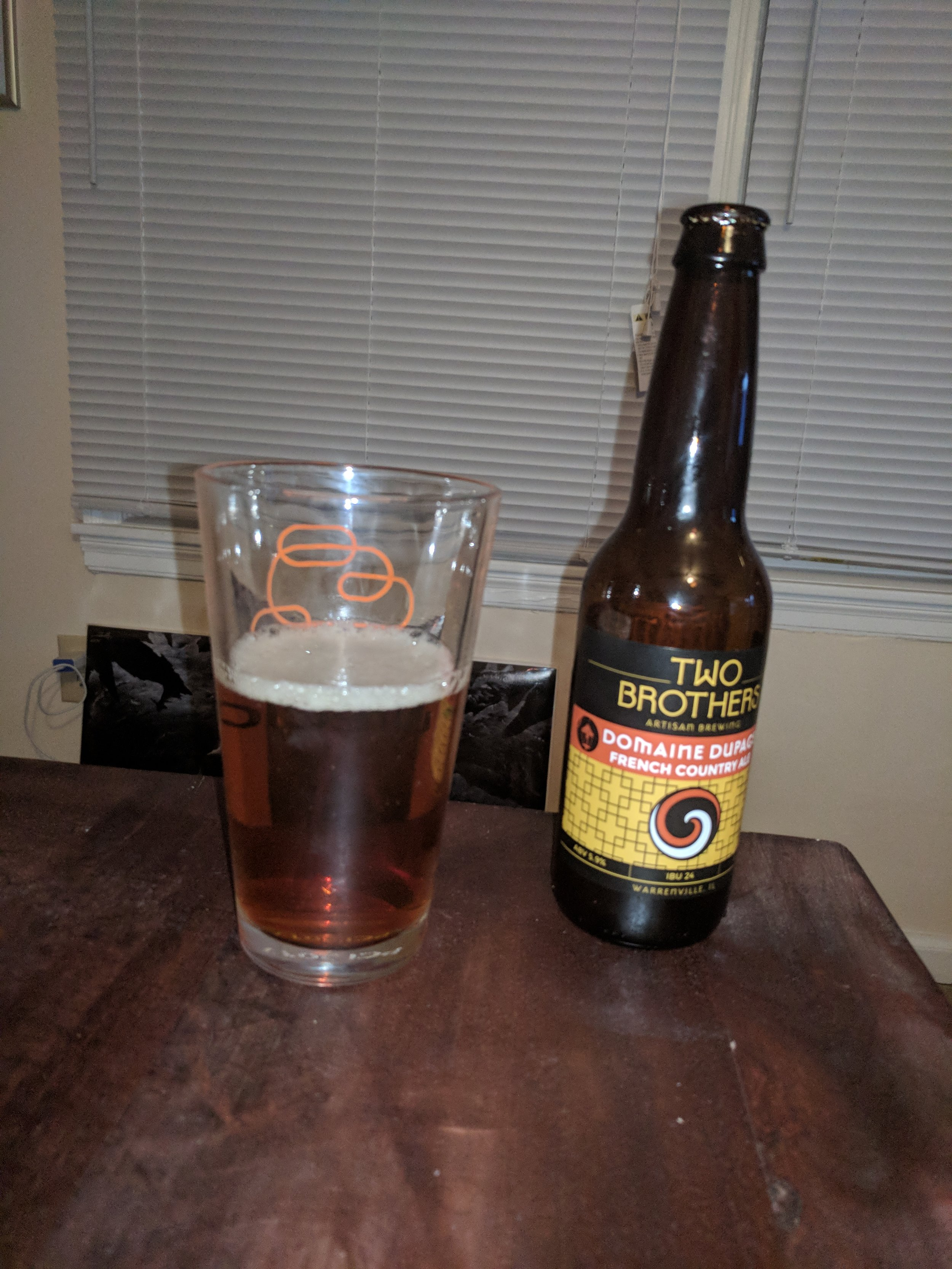 Domaine DuPage - Domaine DuPage from Two Brothers Artisan Brewing is a French Country Ale that we tasted on Episode 20. I am just going to say at the very beginning that this beer was quite mediocre. We did not have very much to say about it on the podcast because it is just a bit bland. The flavor is not very strong nor does it linger, and it mostly seems to come from the malt. There is a small bit of bite right on the end, but it is mild. It is an ale that is about as clean as a lager. None of us really enjoyed the beer, but I wanted to do something a bit different. If you are not into interesting/complex beers, this may be the beer for you.