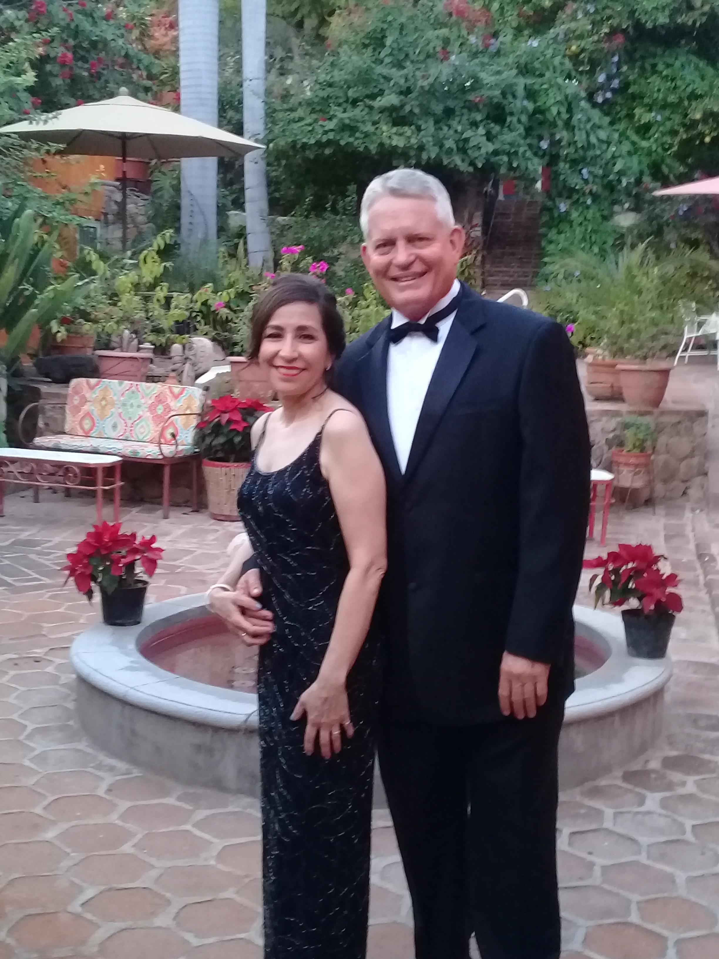 A beautiful couple are off to a wedding at Hacienda de los Santos just one half block away.