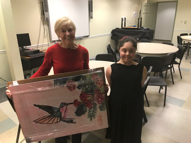 Sophia delivering one of her pieces to a member of Holy Trinity's Sheppard's Flock Community