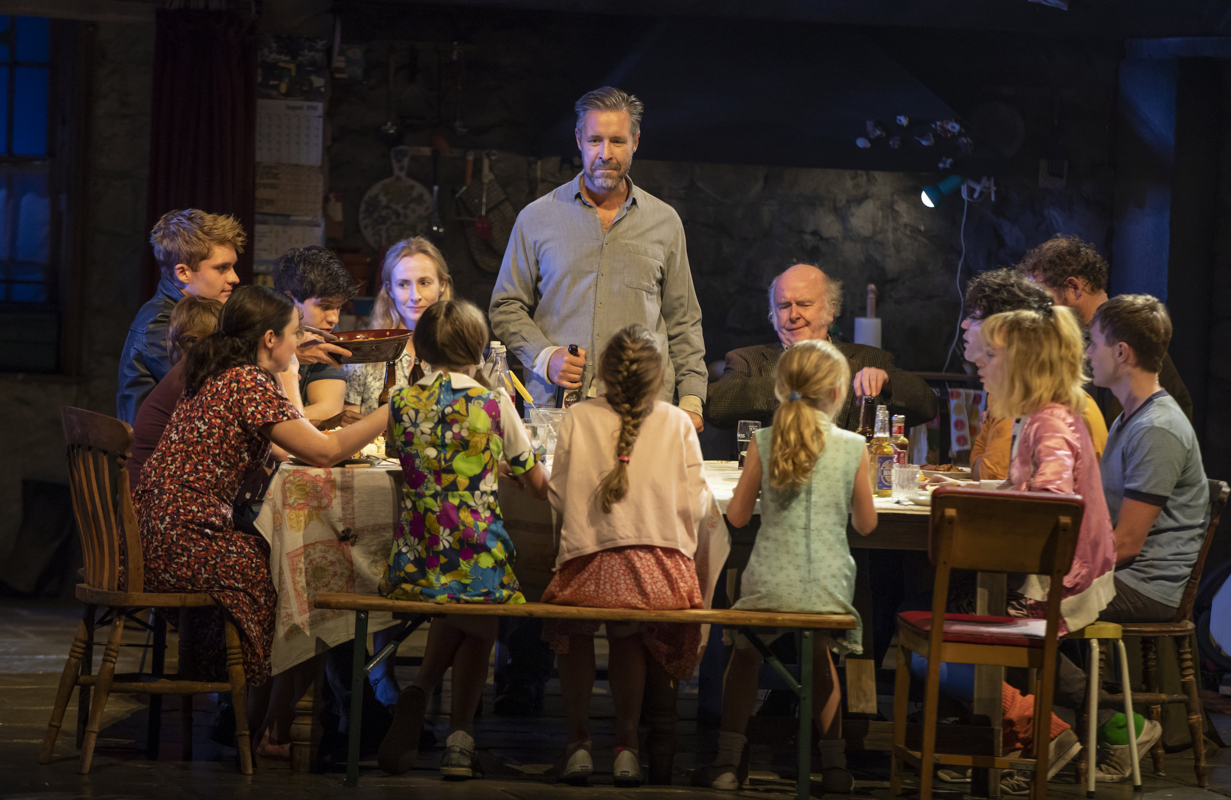 """Paddy Considine (Quinn Carney–center, standing), and the company of """"The Ferryman"""". Photo Credit: Joan Marcus."""
