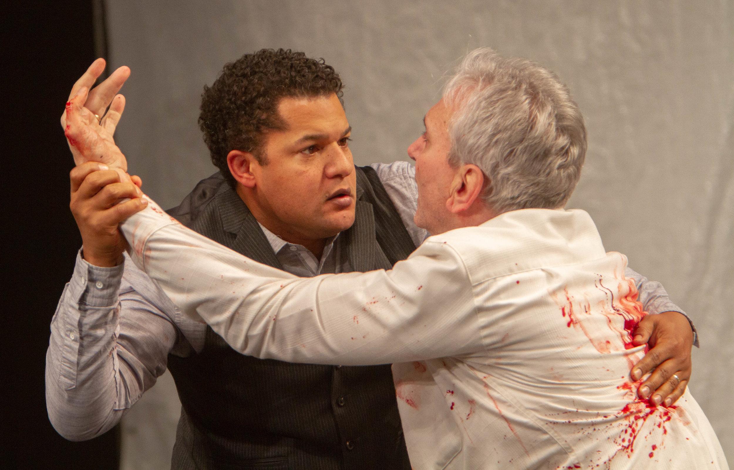 Brandon J. Dirden as Brutus and Rocco Sisto as Julius Caesar. Photo Credit: Henry Grossman.