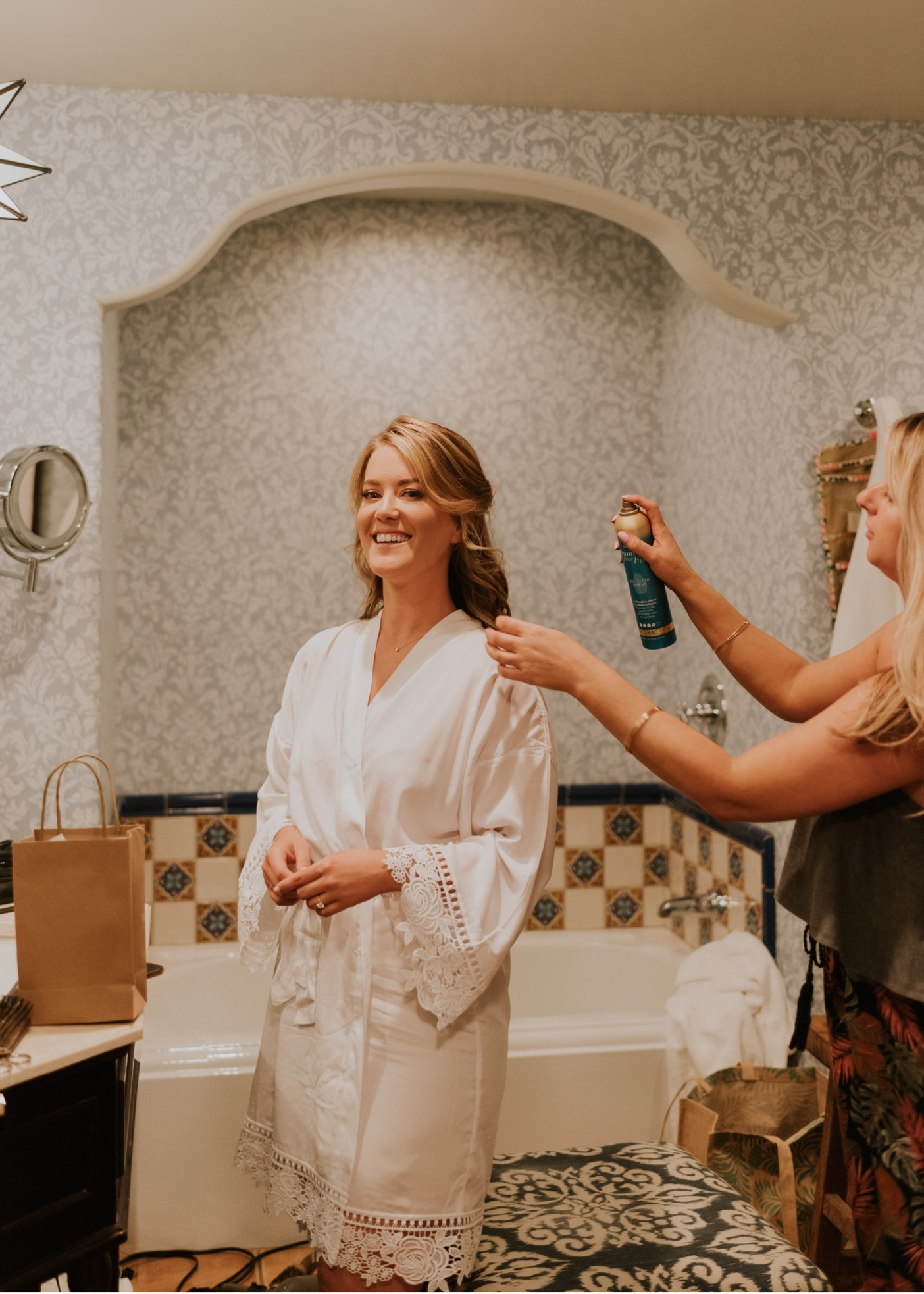 Bride reaction to wedding day makeup. Getting ready at Canary Hotel Santa Barbara.