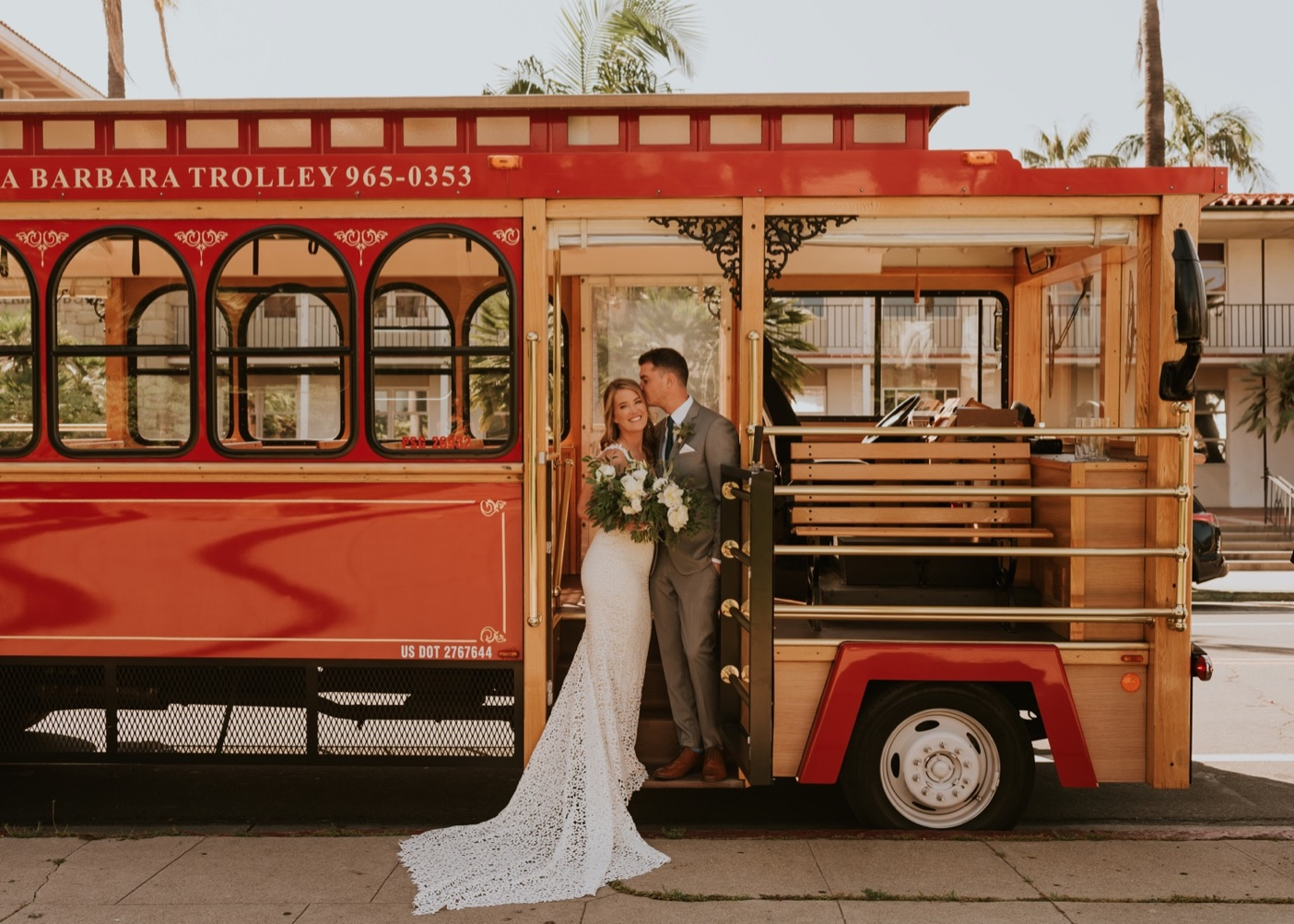 Bride and Groom on Trolley Car. Santa Barbara Courthouse Wedding.
