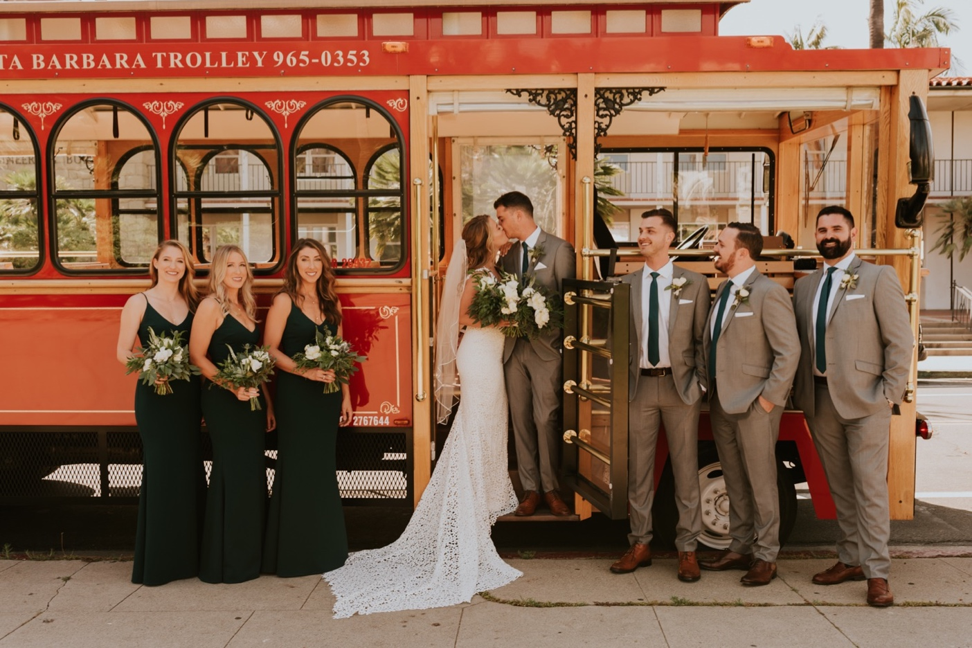 Bride and Groom on Trolley Car with wedding party on both sides. Santa Barbara Courthouse Wedding.