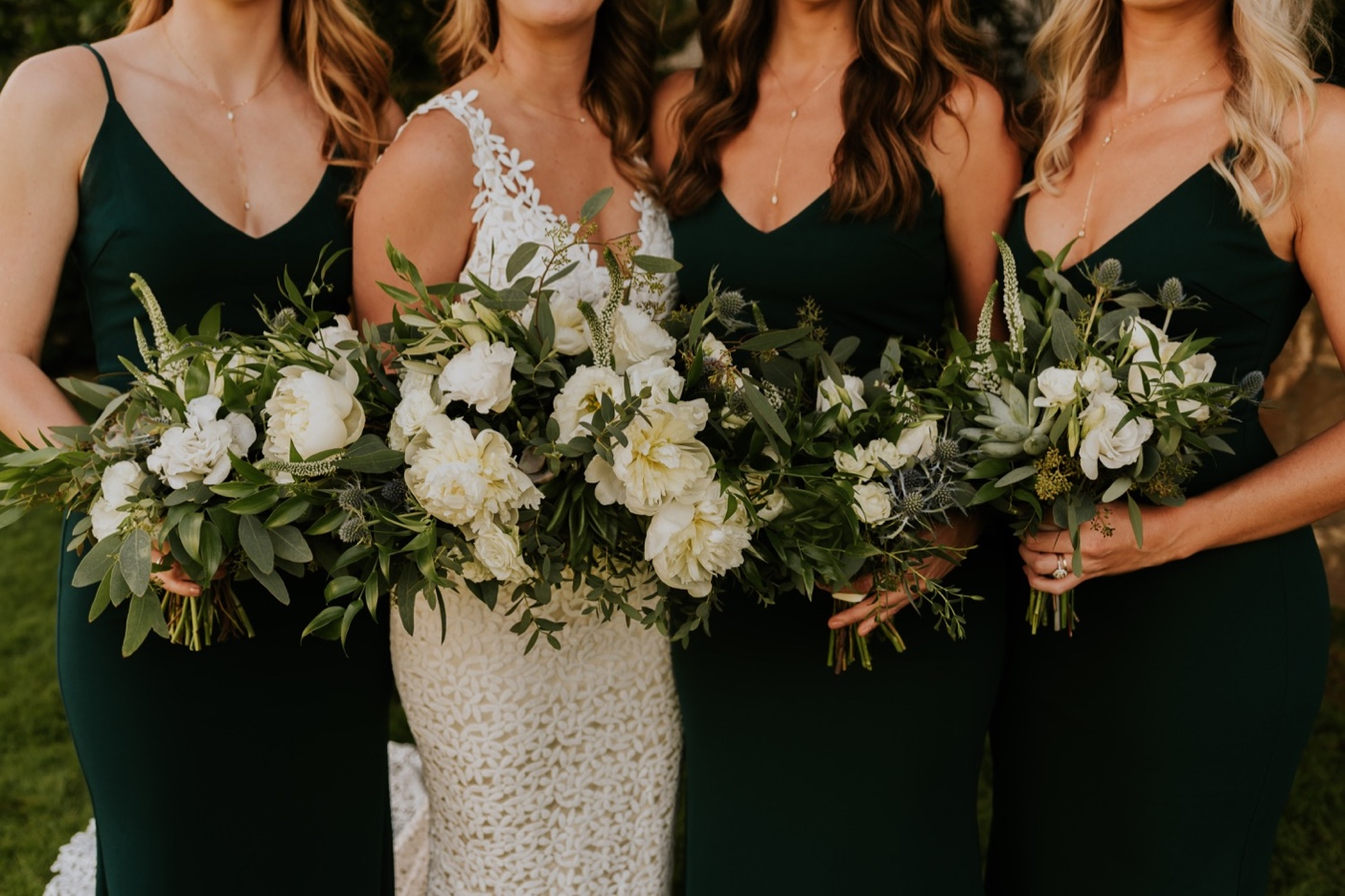 Bridesmaids in green dresses with bride. Wedding Floral Bouquets. Santa Barbara Courthouse Wedding.