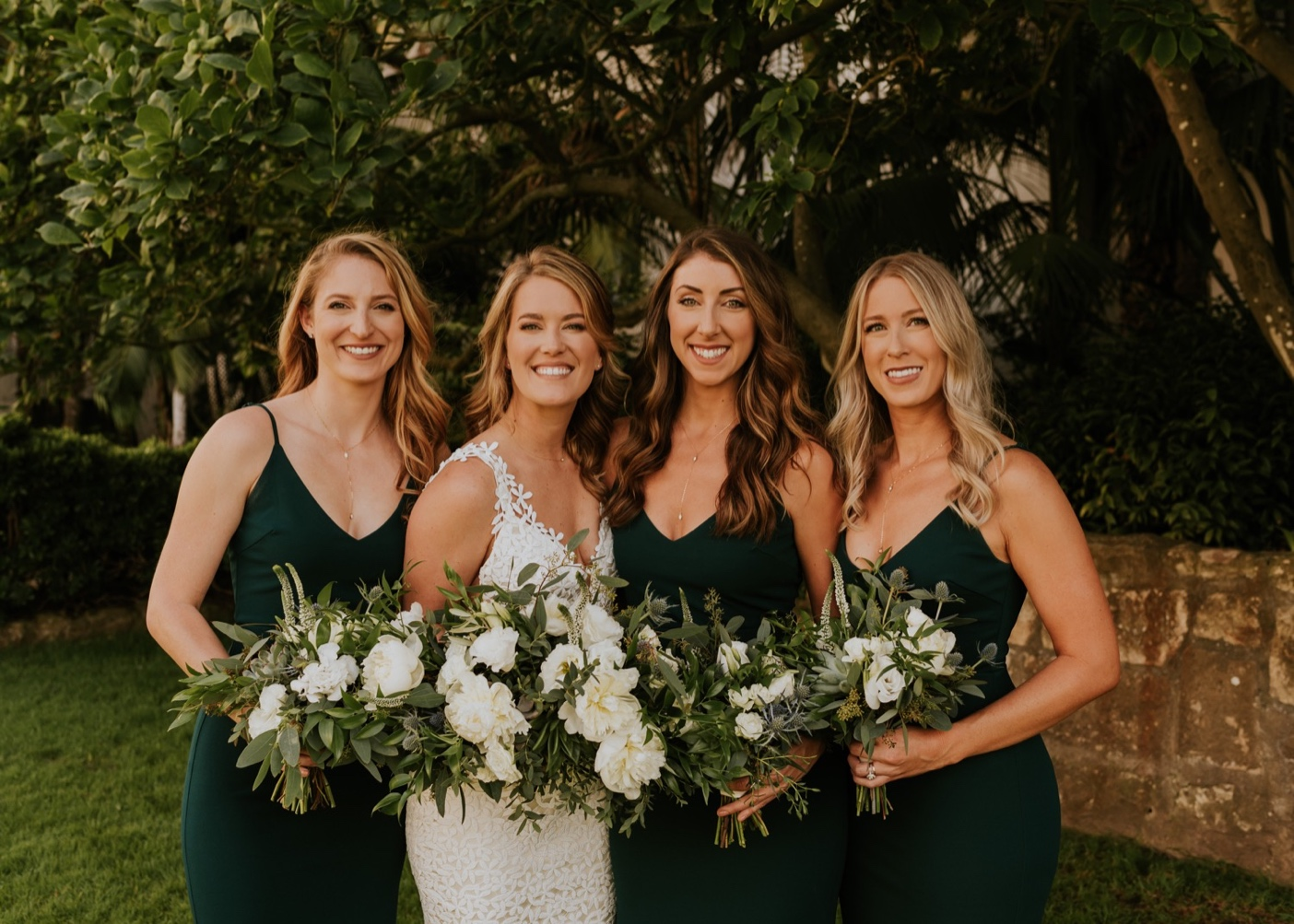 Bridesmaids in green dresses with bride. Santa Barbara Courthouse Wedding.