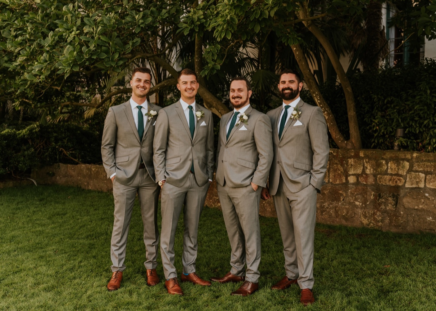 Groomsmen with Groom on outdoor lawn. Santa Barbara Courthouse Wedding.