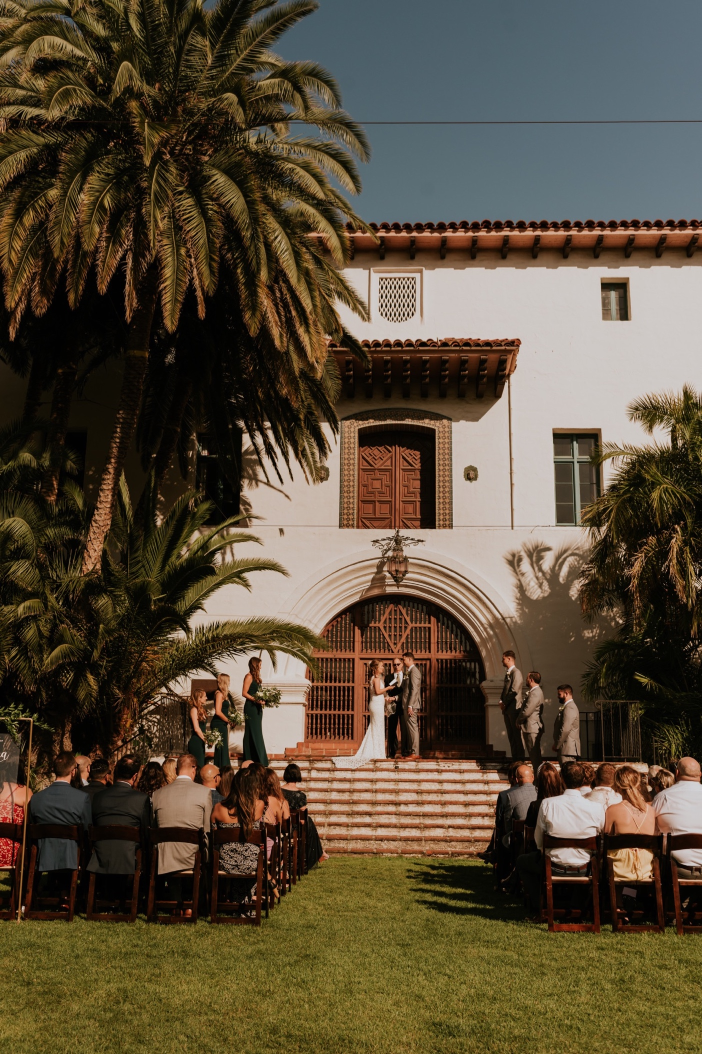 Wedding ceremony on outdoor lawn at the Santa Barbara Courthouse.