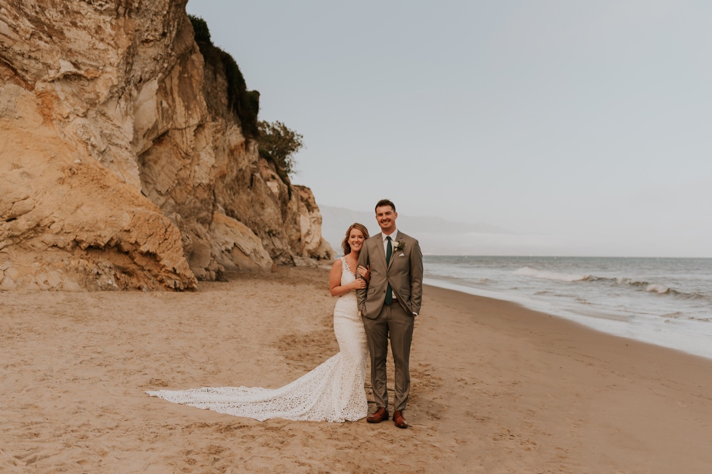 Bride and Groom Portraits on beach in Santa Barbara, California. Santa Barbara Wedding.