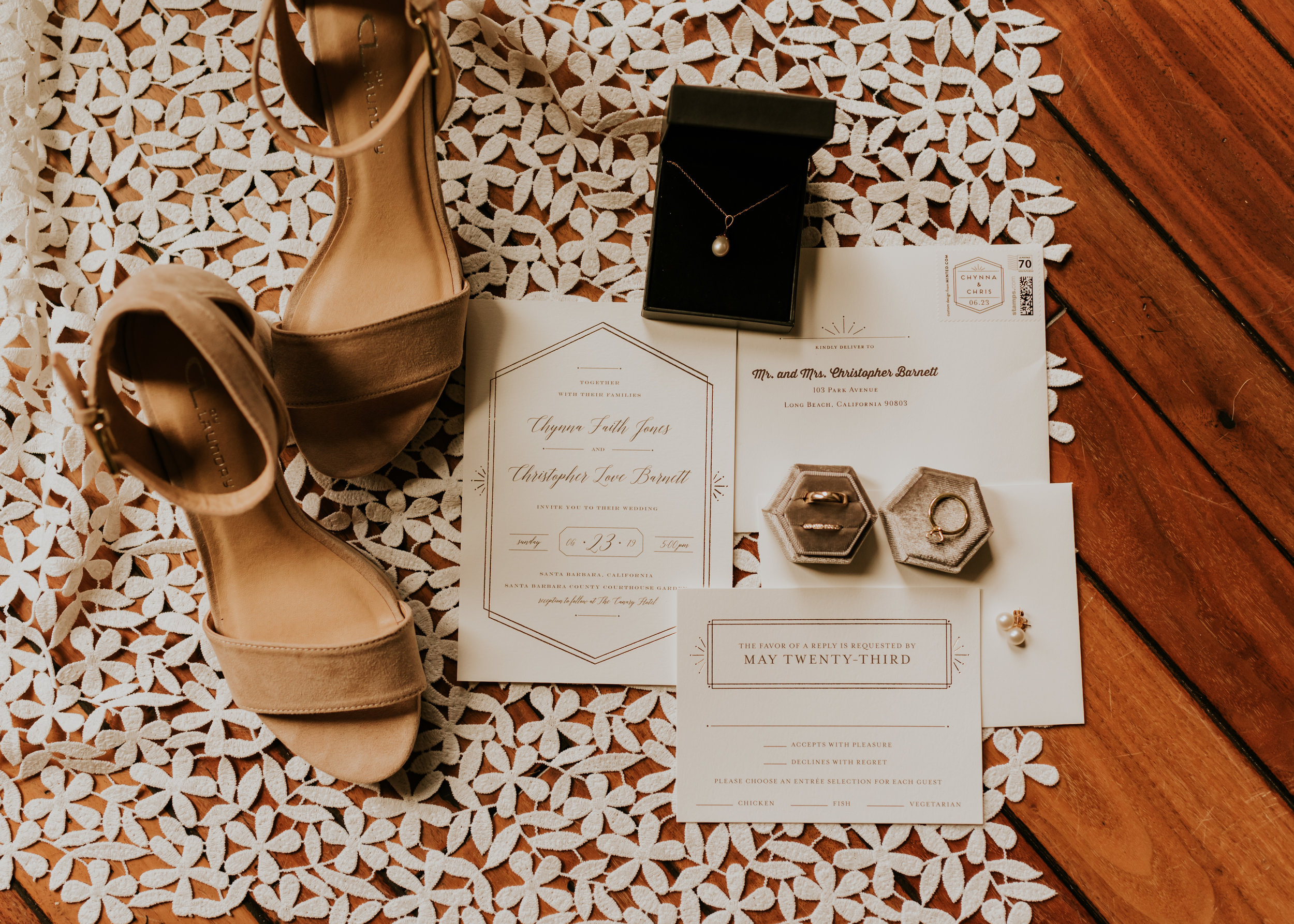 Wedding detail flatlay with bride's shoes, invitation suite, and jewelry. Santa Barbara Wedding Photography