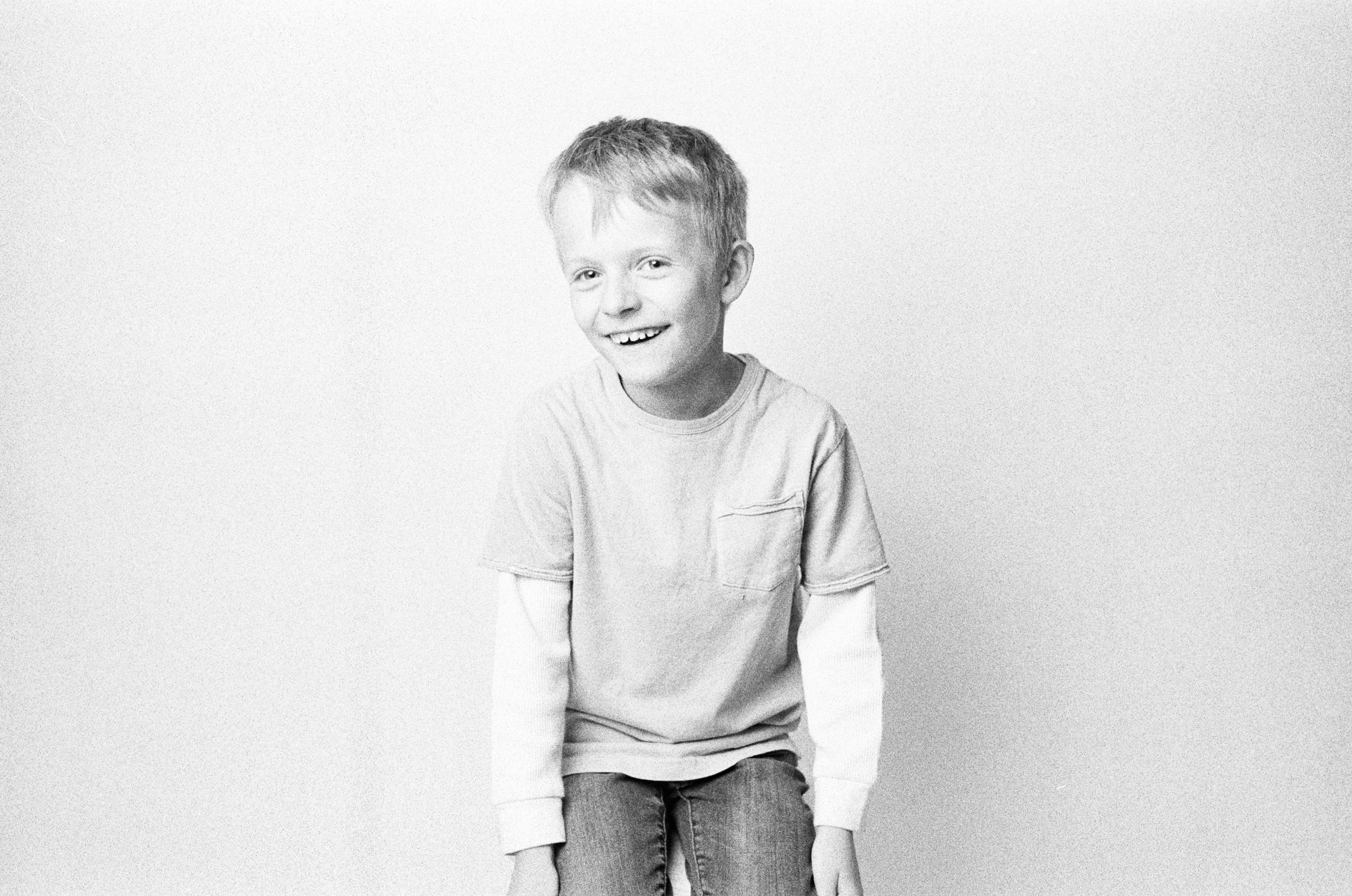 Kid-Laughing-Black-and-white-film-HP5-Nikon-F100-Film-Photographers.jpg