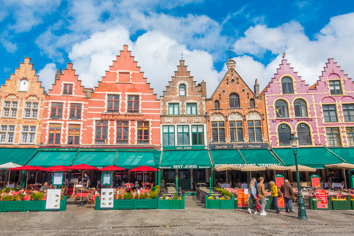 Bruges - All of the restaurants have seating areas outside facing the center of the square. Perfect way to take in the city + culture!