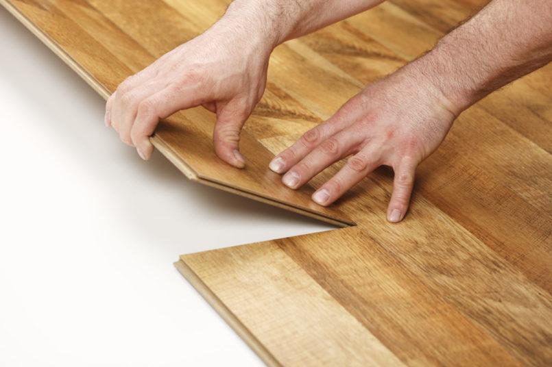 wood-laminate-flooring-installation-in-brown-colors-805x536.jpg