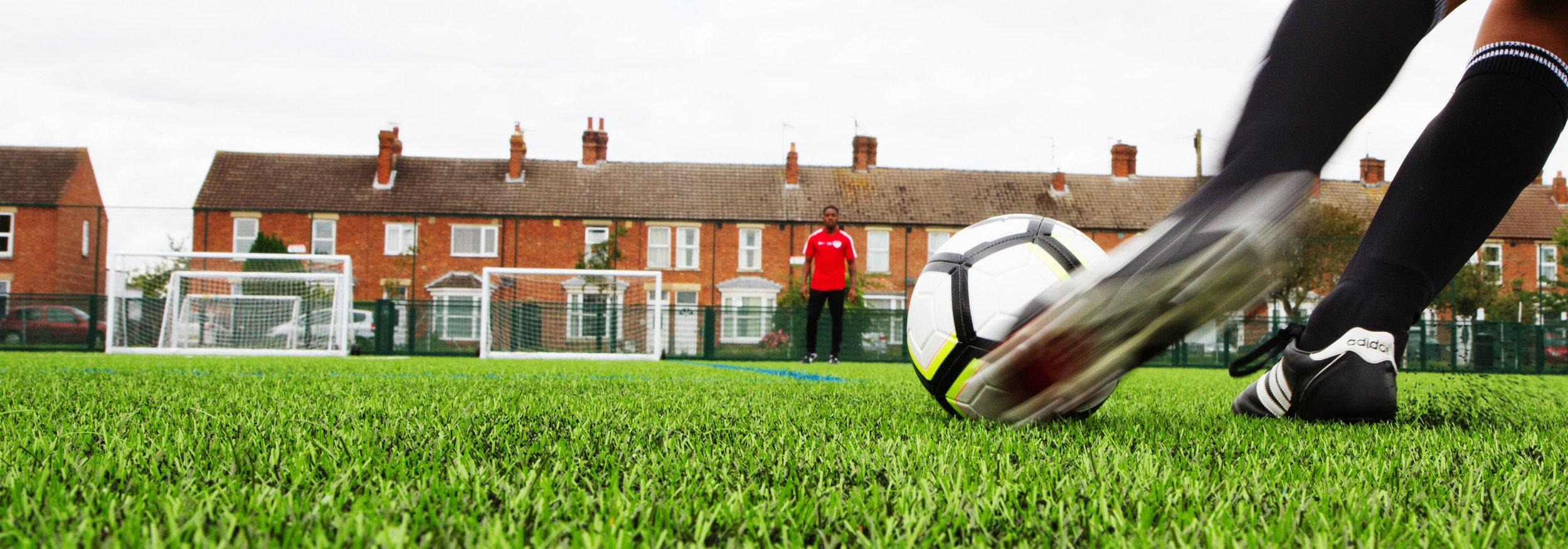 Kicking the Ball at Football Training in Bristol