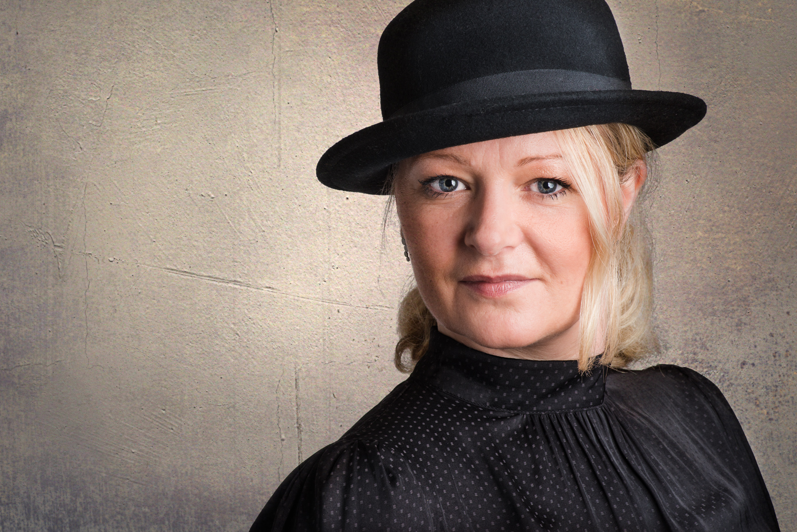 woman in bowler hat