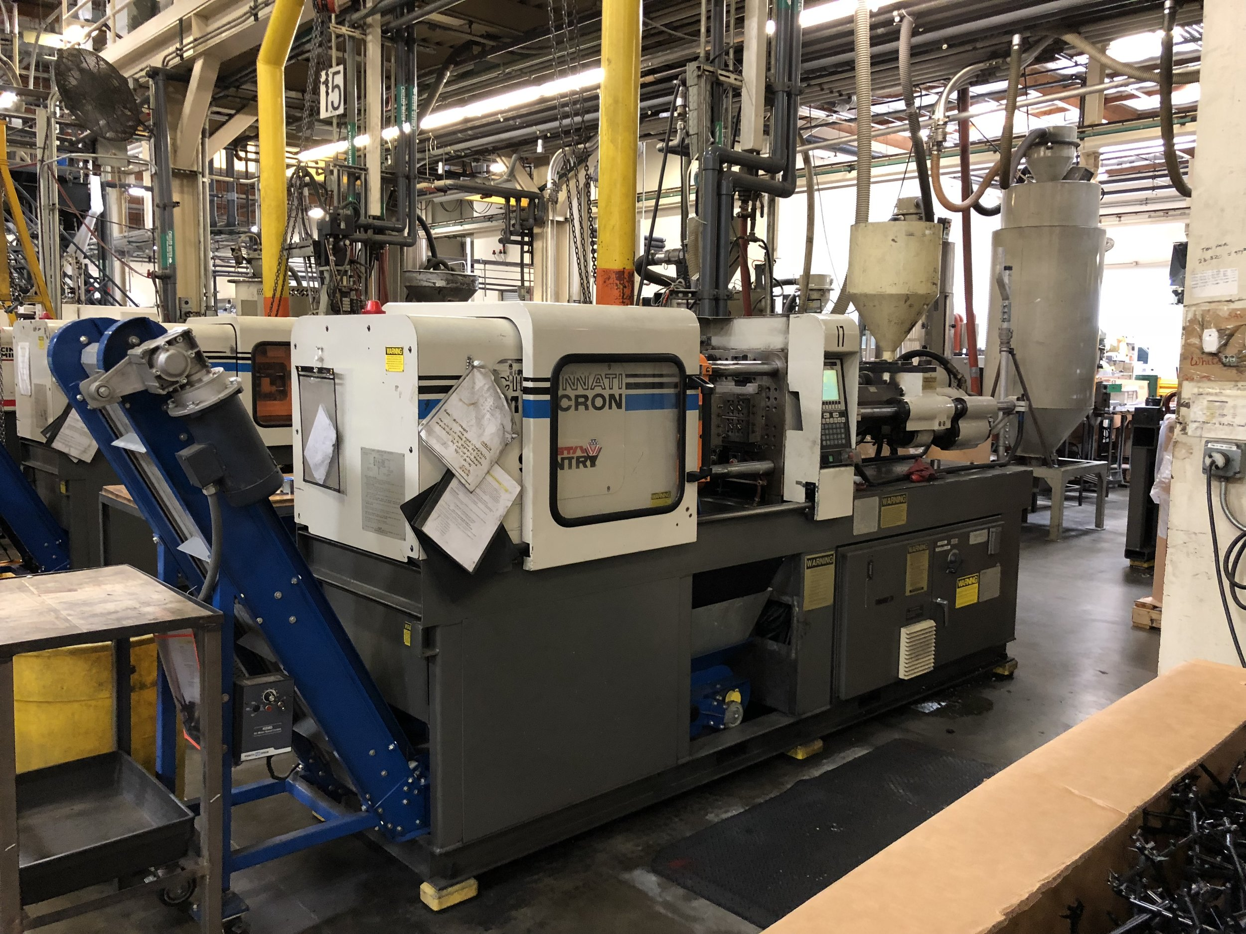 A small injection moulding machine.  Source