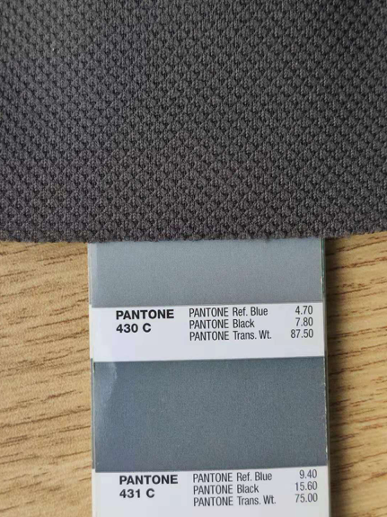Our Pantone color, next to a fabric sample that shows the texture. The next fabric order should match the Pantone reference better.