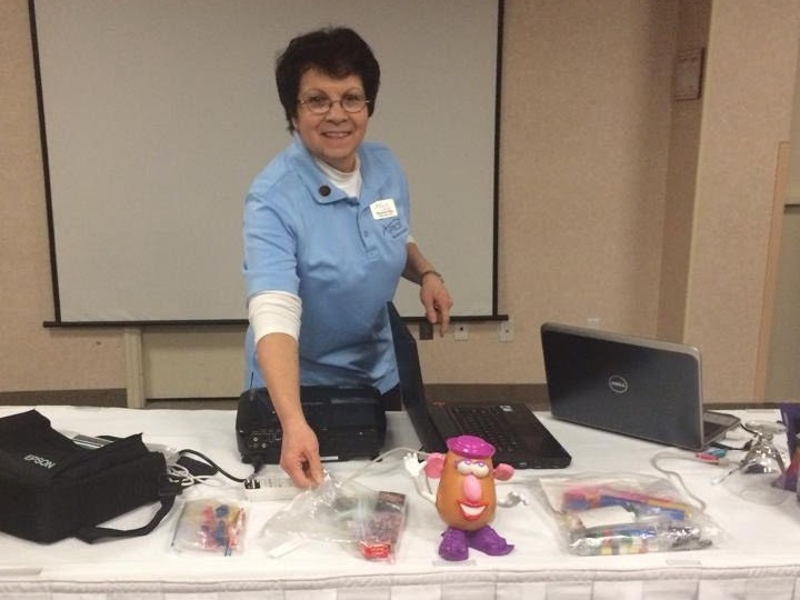 Maryanne arranges her materials before a Train the Trainer presentation.