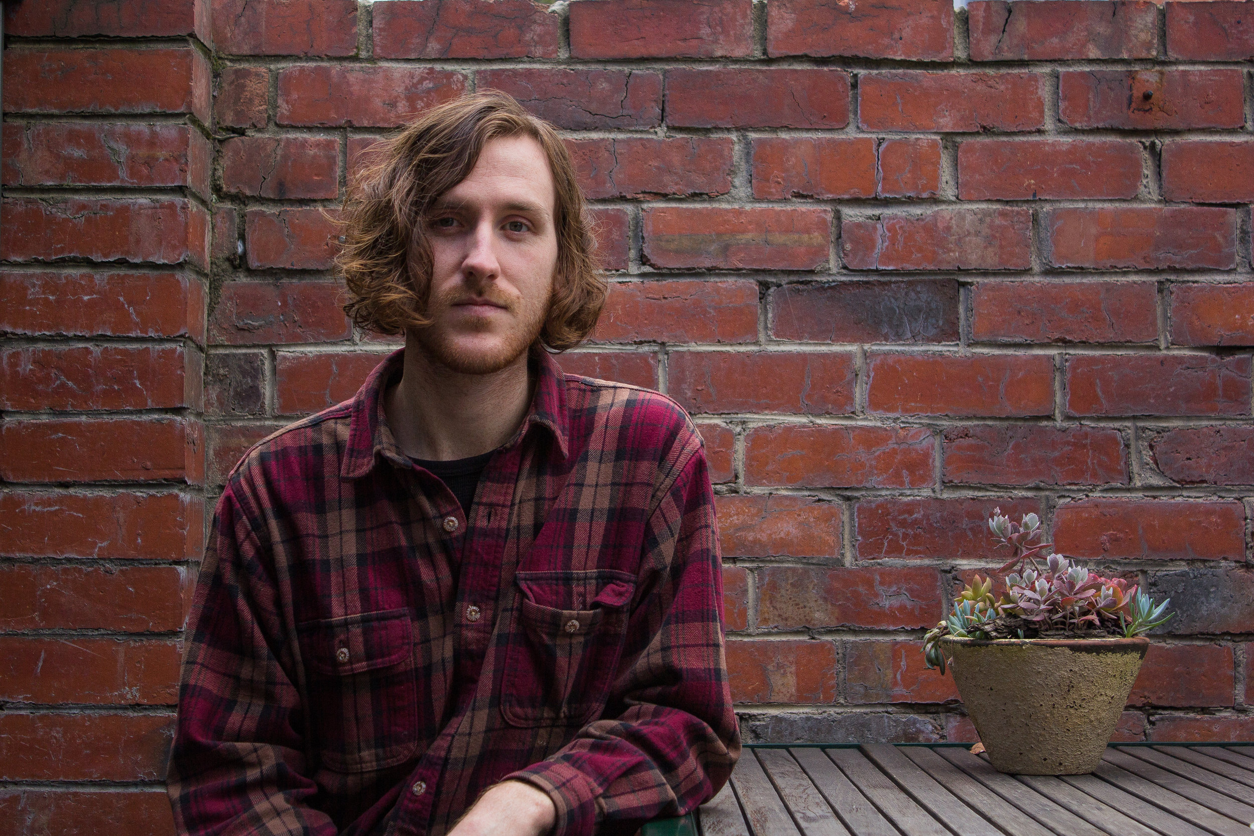 We caught up for a cuppa coffee with Alexander Biggs ahead of the release of his debut EP 'Still You Sharpen Your Teeth' (out today 15th). The Melbourne indie-folk producer has only gone from strength to strength, scoring some huge support slots as well as touring his own live show. With a bunch of dates coming up in support of the EP including a couple of showcases at BIGSOUND, we wanted to sit down and have a chat about all the Bigg(s) things