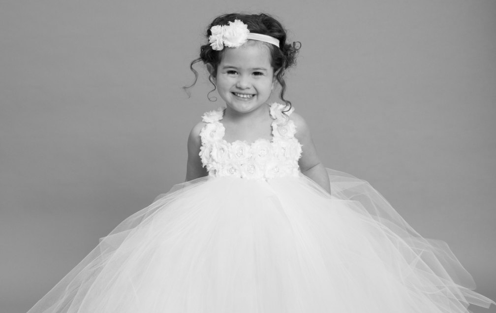flower girl - All of our flower girl dresses are custom made. We have a handful of styles available in store but we are able to custom design and create your dream dress! The options are endless...