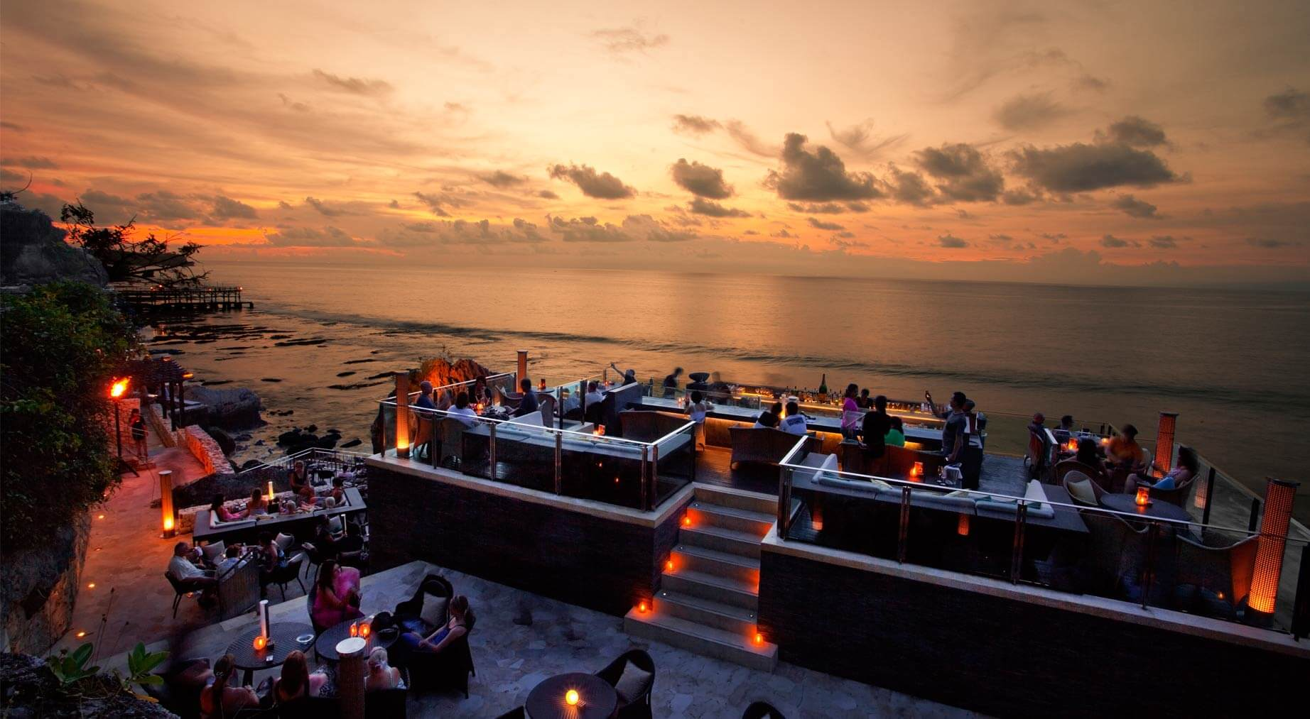 Raised 14 metres above the vast Indian Ocean, Rock Bar is nestled atop the rocky coastline of Jimbaran - a prime spot for watching the sun seamlessly set into the sapphire sea. Coupled with a glamorous sultry ambience and chilled cocktail, the luxurious hang out's panoramic views are absolutely breathtaking. As part of luxury resort AYANA, the exclusive spot can only be accessed via a complimentary cliff side cable car. Slip on your glad rags, and relish in a special gathering or fairy-tale date at Rock Bar. - Rock Bar at Jimbaran