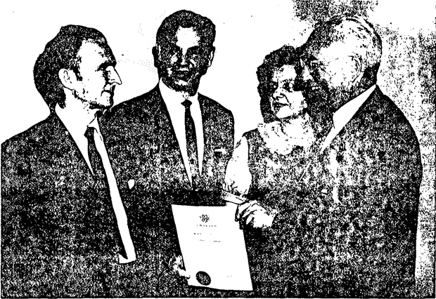 Donald Riley (right), Executive Director of ASA, presenting the Atlanta Chapter Charter to Ovid H. Stephenson (left), while Brunswick A. Bagdon and Emily Roberts observe.