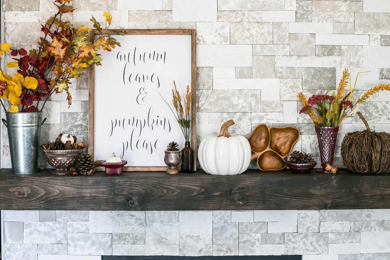 We love how she incorporates different textures and finishes in this charming fall mantel look.