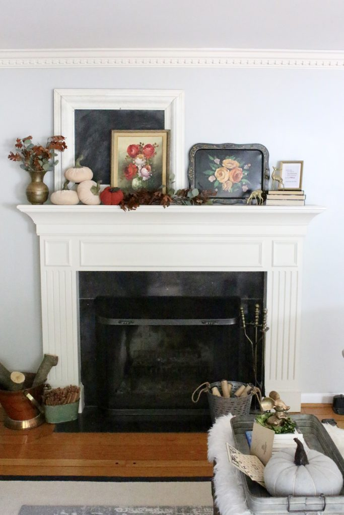We love the way she layers different elements and is mindful of height and scale in her vintage, classic mantel for fall.