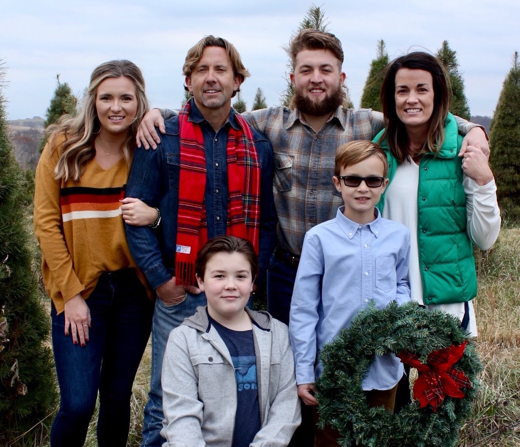 """Kidney donor Colby (top, second from left) with wife Amy and their kids. Colby's family fully supported his kidney donation to a young man who was a family friend and someone Colby considers his """"surrogate son."""""""