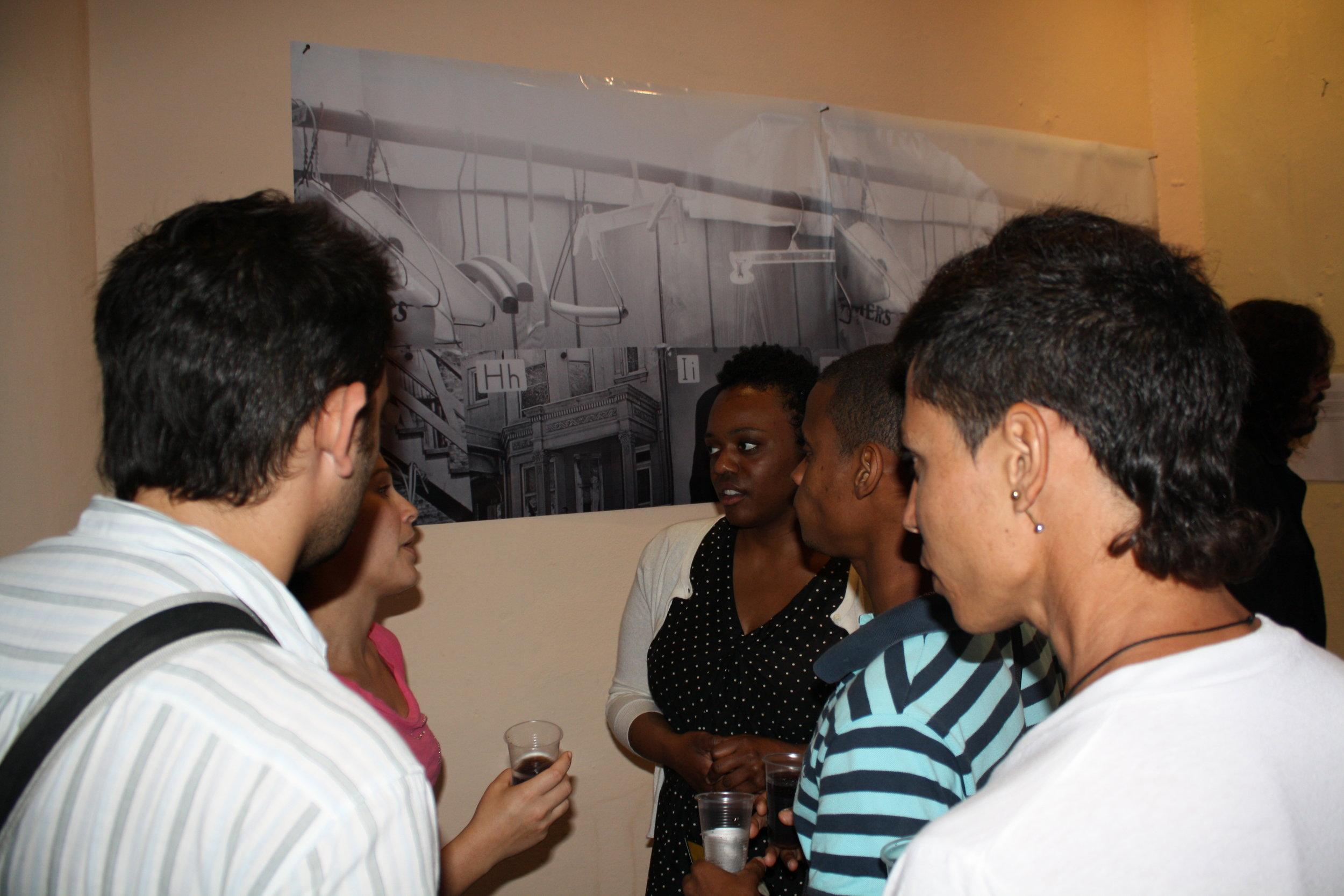 Leslie Hewitt talks to visitors at her Aglutinador opening in 2012.
