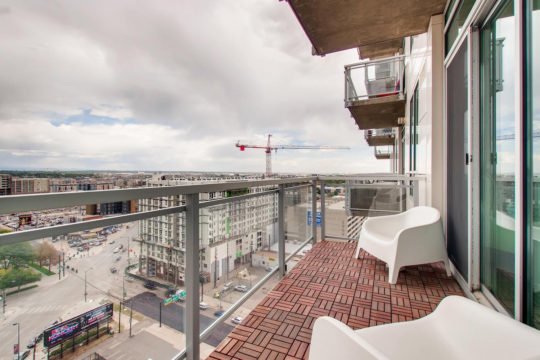 2001 Lincoln St 1413 Denver CO-large-027-027-Master Bedroom Balcony-1500x1000-72dpi.jpg