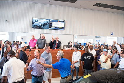 Ray Nichols sells the first car to cross the block at the new Bel Air Auto Auction