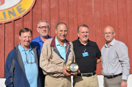 Tony Tur (center), is congratulated on his 20-year auction anniversary by members of the auction's sales team (left to right): Jim Terwilliger, Sales Manager; Mike Canzler, Sales Representative; Bernie Andrews, Dealer Relations Manager; and Jerry Marble, Sales Representative.