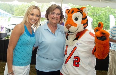 Miss South Carolina Suzi Roberts and the Clemson Tiger mascot join Carolina Auto Auction owner Patty Stanley for lunch during the Annual Charity Golf Tournament.