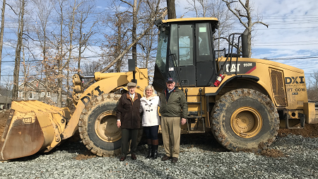 BSC America's Chairman Ray Nichols, Executive Vice President Michelle Nichols and President R. Charles Nichols survey 12 acres being prepared for expanded parking at Bel Air Auto Auction.