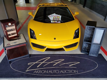 "An Ohio State Buckeys ""stadium view"" end table, and a fully-stocked humidor and wine fridge were the prizes at Akron Auto Auction's Thursday Night Toy Sale, held on May 16th. Customers were invited to stay after the sale for a special casino-themed event."