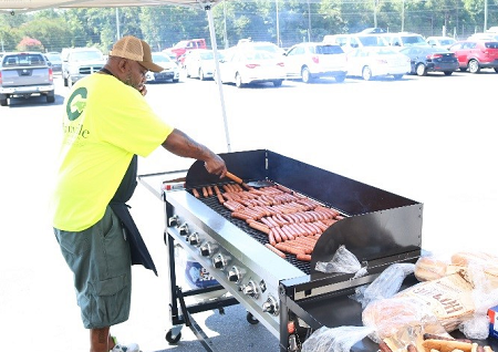 Greenville Auto Auction grilled up hot dogs for all the dealers attending its Red, White and Blue sale in July.