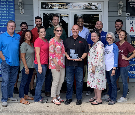 The team at LFCAA celebrates being named Auction of the Year by the Lousiana Independent Auto Dealers Association.