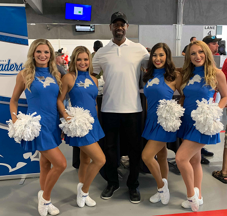 Members of the Detroit Lions cheer squad, and former Detroit Lions wide receiver Herman Moore were on hand at the Annual Tailgate and Corn Roast Sale at FastLane Auto Auction.
