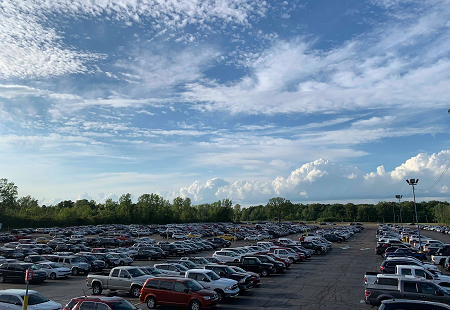 The lot was full, as FastLane Auto Exchange prepared for its Annual Tailgate and Corn Roast Sale, which drew record crowds and sales..