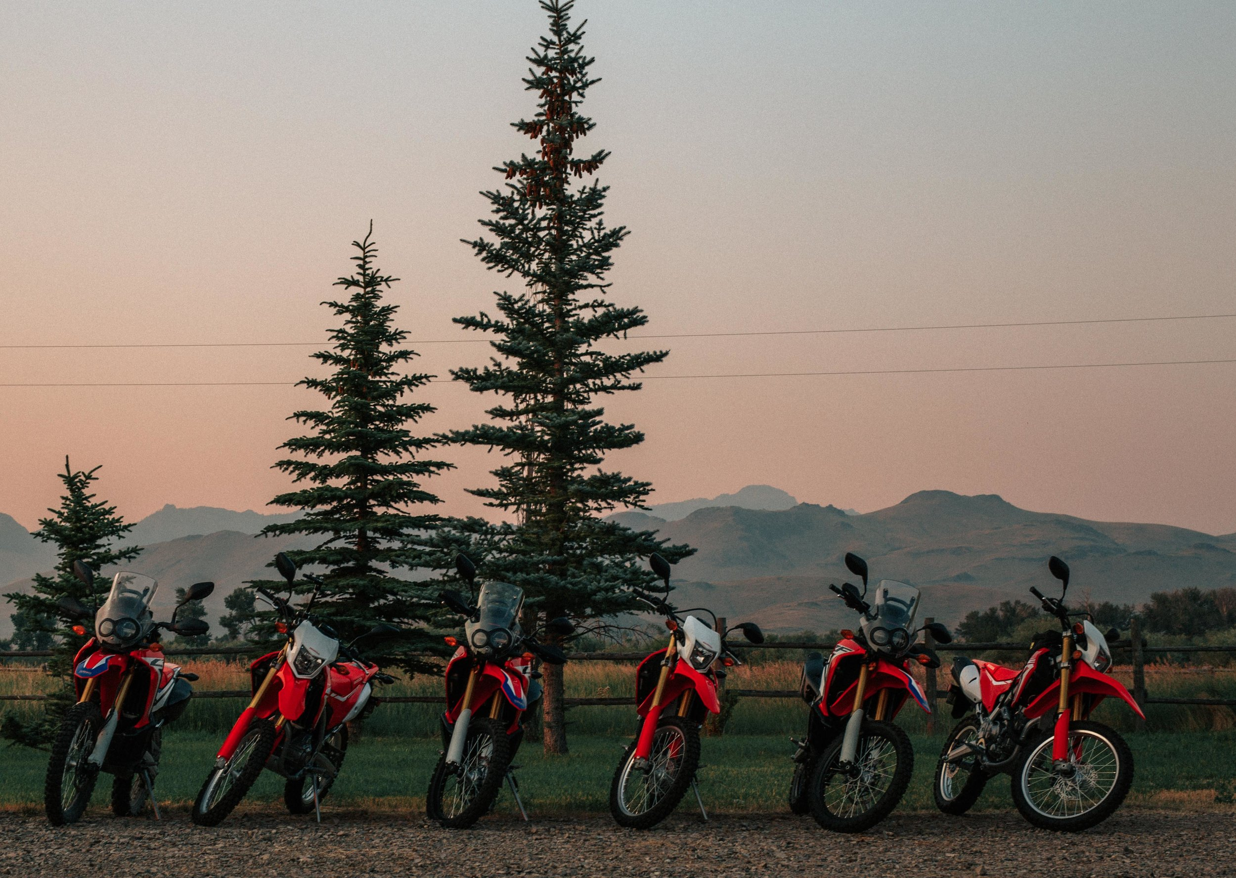HONDA USA Press bikes lined up in front of the cabin the first morning of the 2016 KLIM Dualsport Summit. The views from the cabin were breathtaking to say the least.