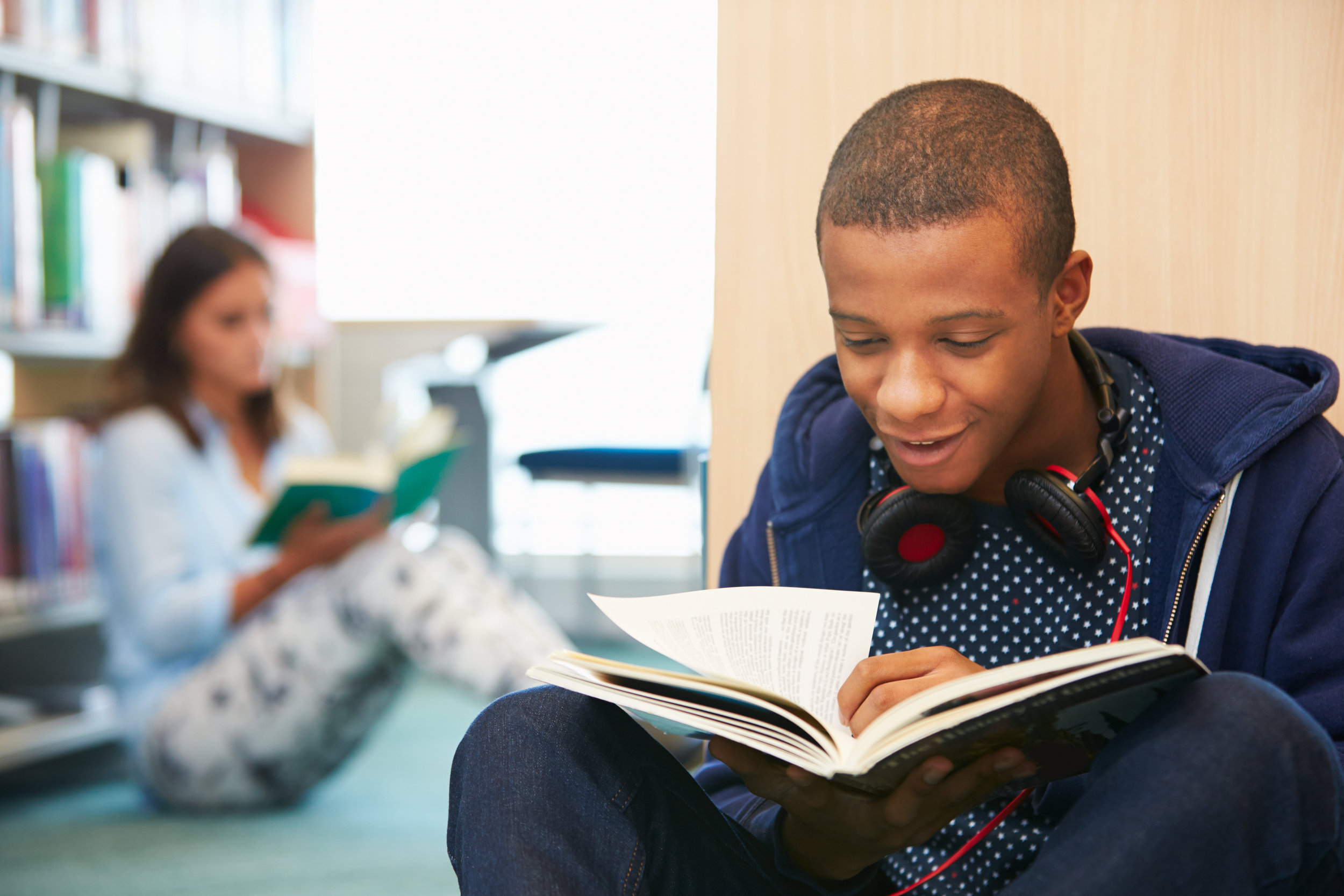 teen homeschool boy studying library.jpg