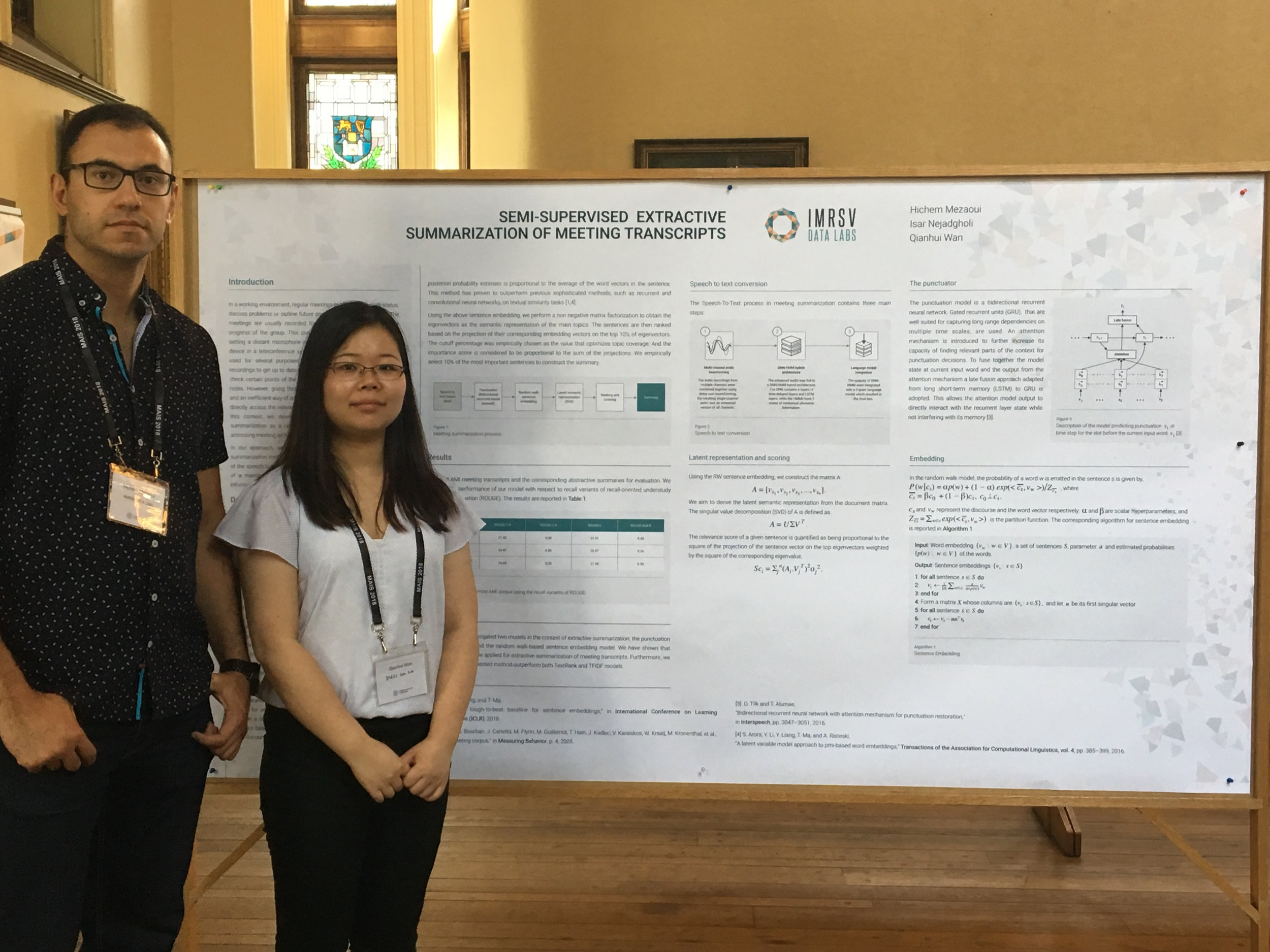 Qianhui and Hichem presenting  Semi-Supervised Extractive Summarization of Meeting Transcripts  on what was described as the largest poster board at the Montreal AI Symposium