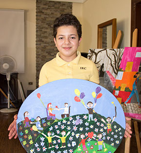 Khaled, a young Syrian refugee, receives expressive art therapy at the Al Bader Center in Amman, Jordan.