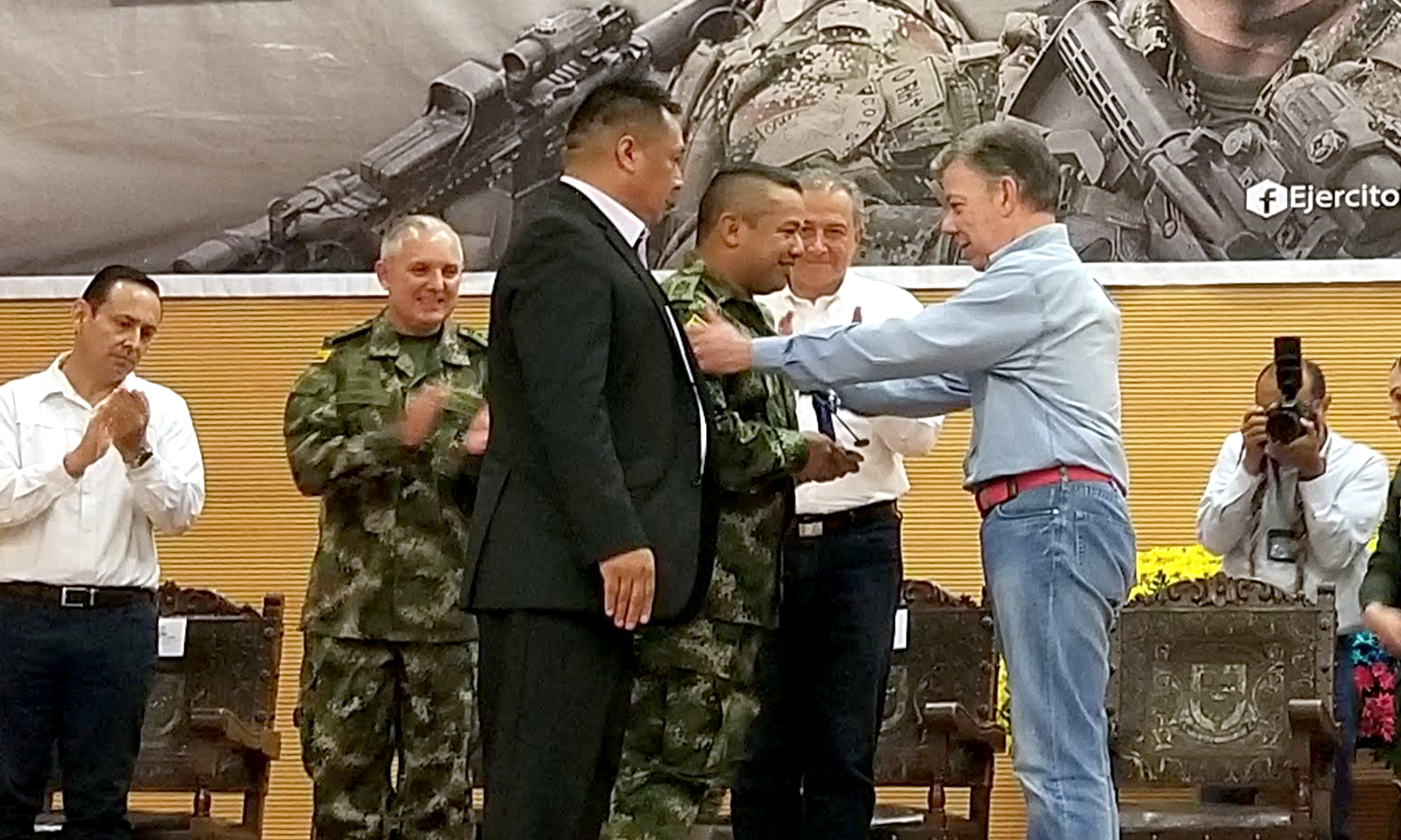 Adelmo receiving an award from the President of Colombia, for his advocacy work with landmine survivors