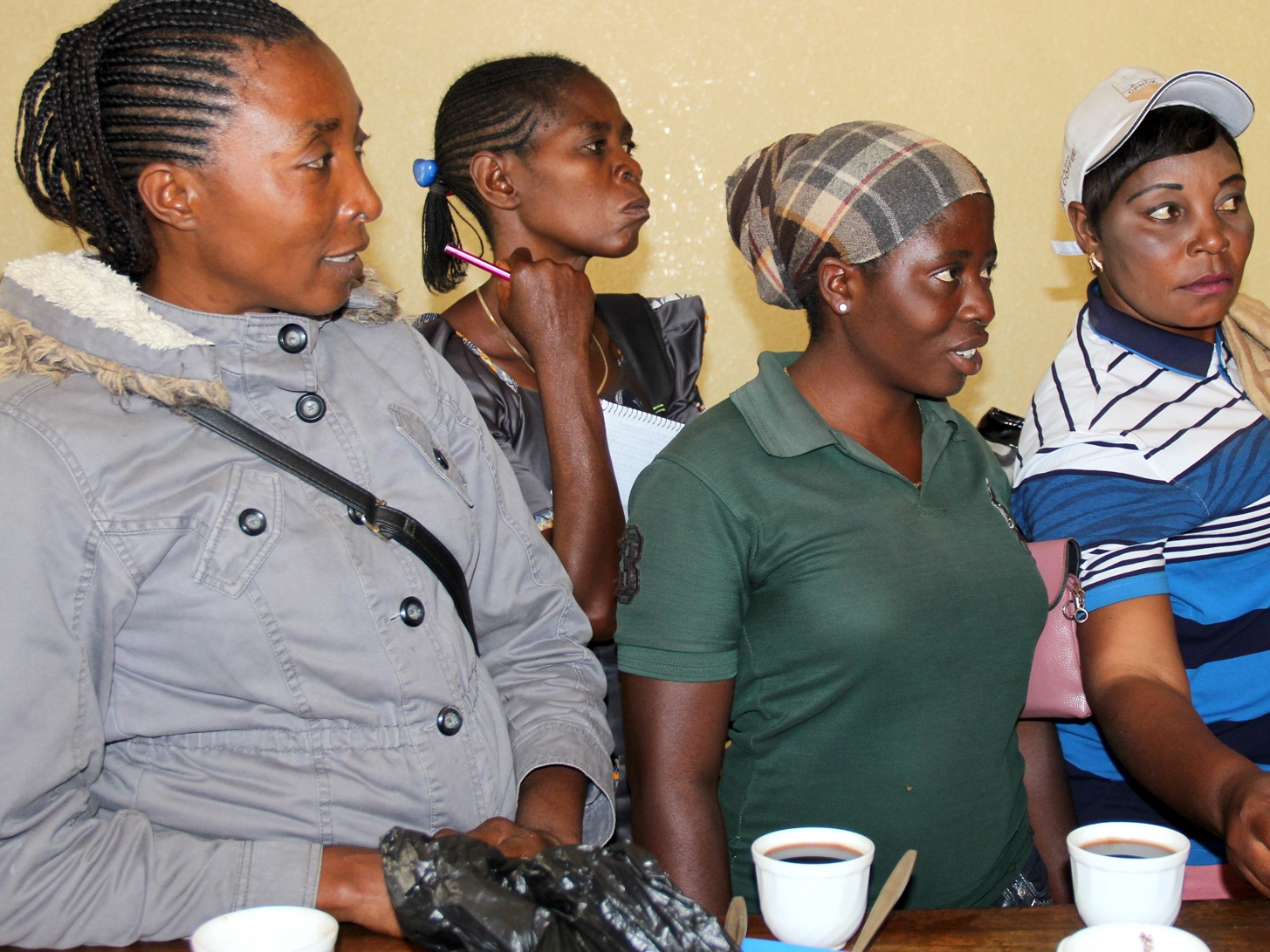 Workshop participants from the program visit a coffee cupping lab.
