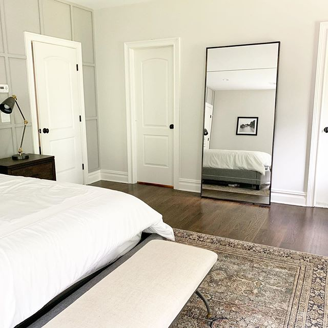 "A tall statement mirror was the perfect piece to fill in this space between the closet and bathroom. It's functional and even more stunning in person. It's 36"" x 78"" and if you look closely you can spy a framed @juniperprintshop beauty on the wall.  Design and 📷 by @christieadamsdesign - - #smmakelifebeautiful #masterbedroomdecor"