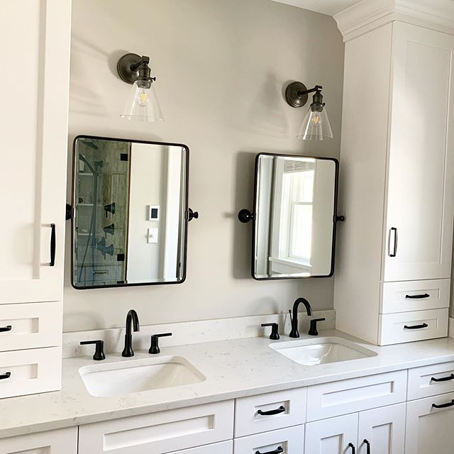 I'm obsessed with my client's completed master bathroom project! When the time finally comes for my own master bath to get a refresh, having 2 sinks and 2 mirrors and lots of storage are all on the must have list!  Design and 📷 by @christieadamsdesign - - #blackandwhitebathroom #masterbathroomdesign