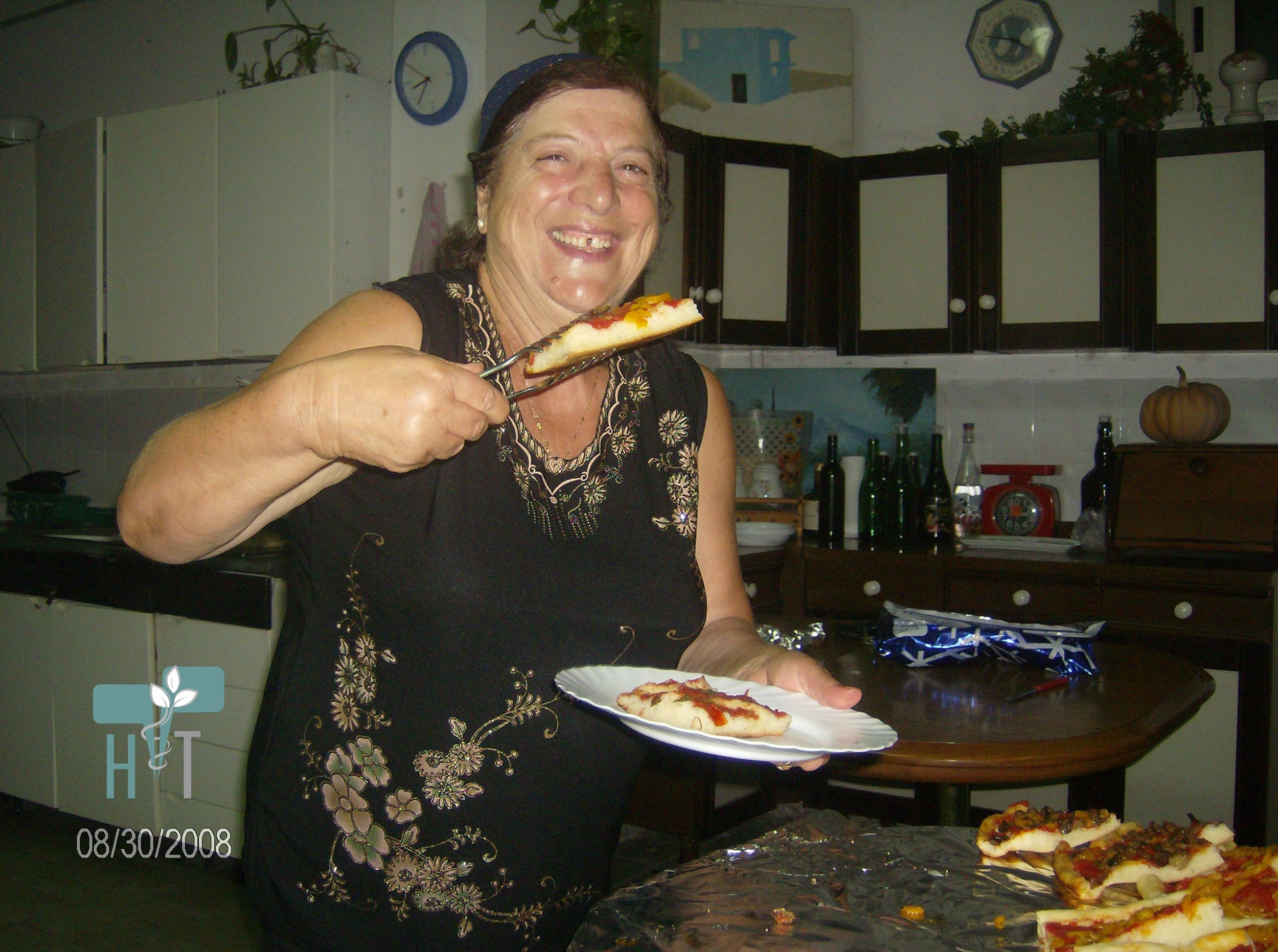 My perfectly wonderful Italian landlady in Naples, Titi, cooking her homemade pizza.